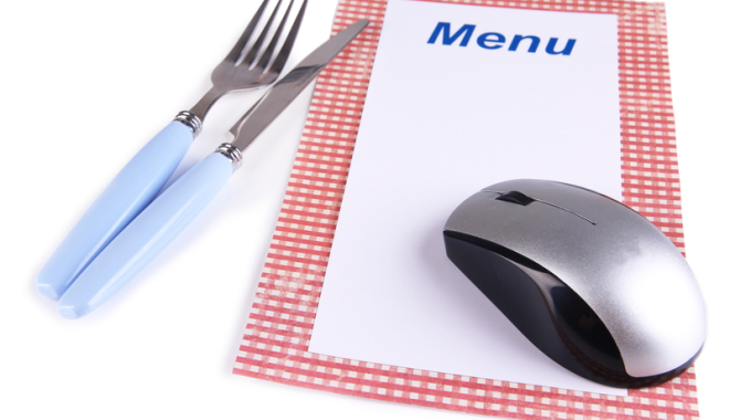 Computer mouse with menu and cutlery isolated on white