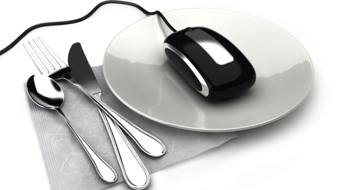 Concept with mouse on a plate ordering food,takeout or groceries online. On a white background