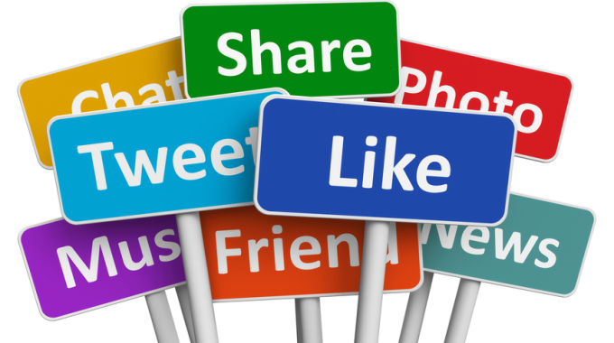 Social media and networking concept: group of color signs with social media services isolated on white background
