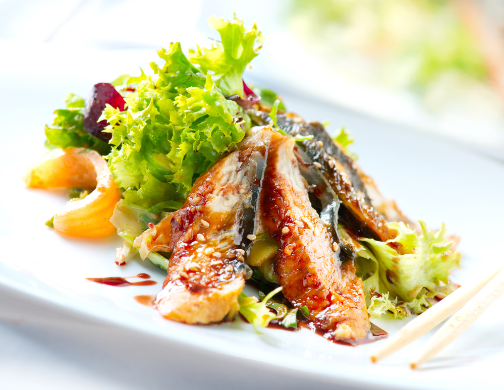 Salad With Smoked Eel with Unagi Sauce. Japanese Food
