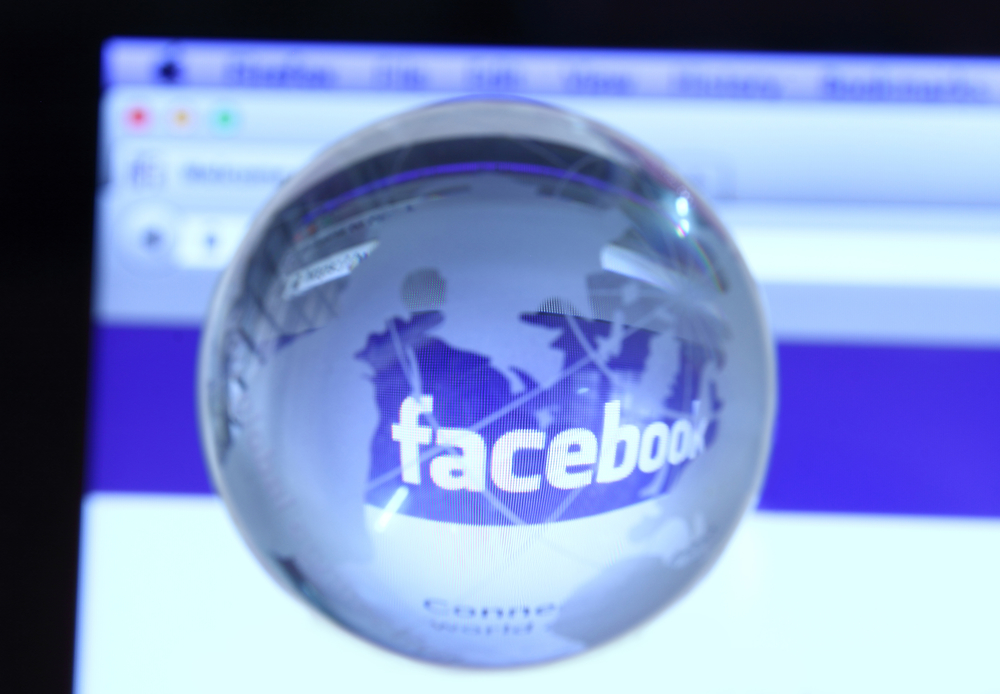 Johor, Malaysia - Sep 6, 2013: Photo of Facebook webpage with glass globe. As of today, Facebook is the largest social media network on the web, Sep 6, 2013 in Johor, Malaysia.