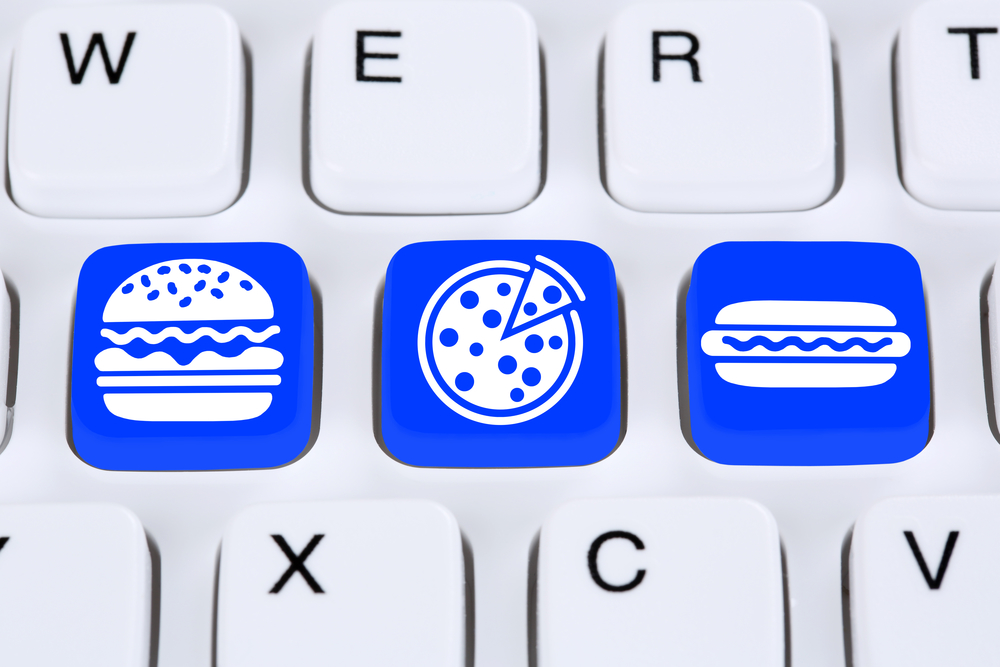 Ordering pizza hamburger online fast food order delivery fastfood internet on computer