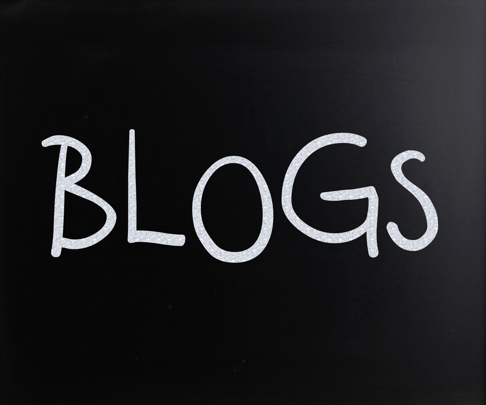 """Blogs"" handwritten with white chalk on a blackboard"