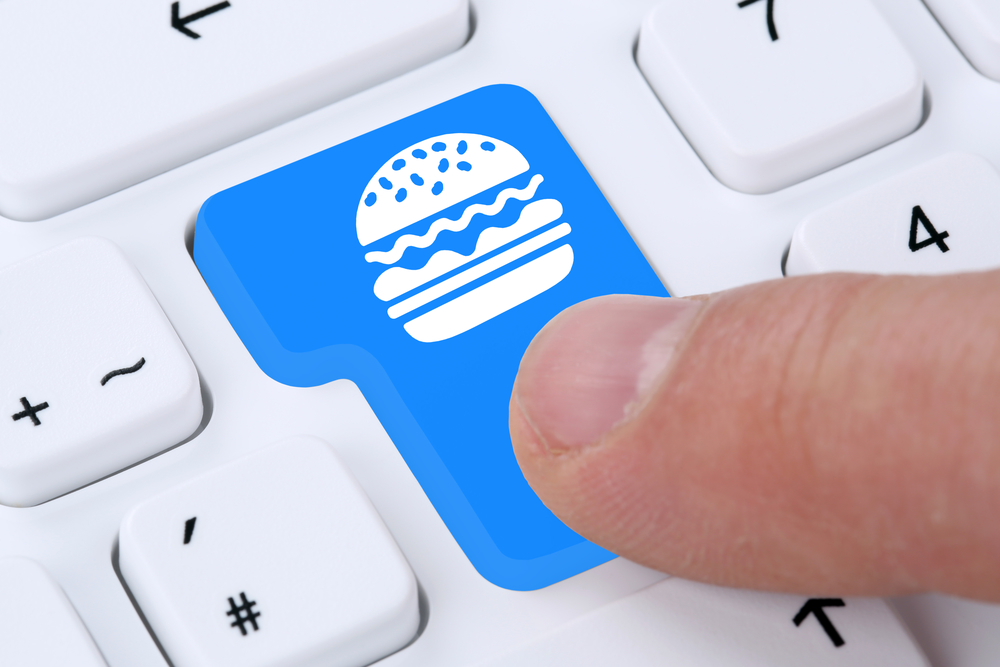 Ordering hamburger cheeseburger online fast food order delivery fastfood internet on computer
