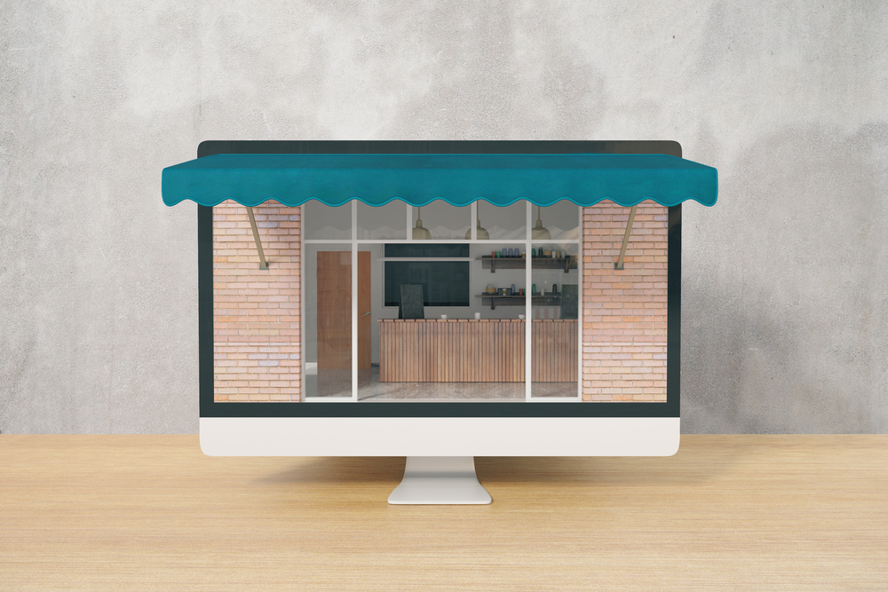 Ordering food online concept with cafe exterior on computer monitor placed on wooden desktop and concrete wall background. 3D Rendering
