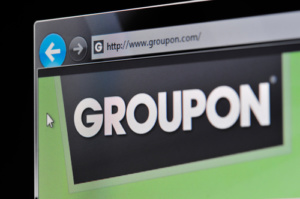 Münster, Germany - March 1, 2011: Groupon Website The website www.groupon.com is displayed on a computer screen.
